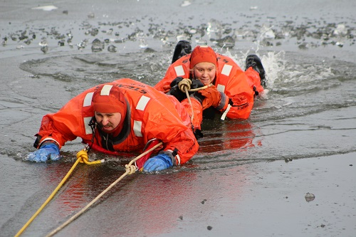 firefighters practicing a water rescue