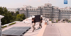 Men installing solar panels on the roof of the White House. (Photo Credit: Creative Commons)