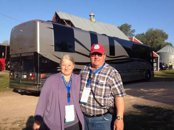 Art and his wife Helen in front of Willie Nelson's bus.