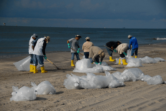 Workers cleaning up a beach during Deepwater Horizon oil spill. (Image Credit: National Institute for Occupational Safety and Health)