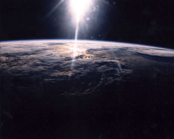 A 35mm camera was used to photograph sunlight over the Earth by STS-29 crewmembers onboard Discovery, Orbiter Vehicle (OV) 103. (Image Credit: NASA)