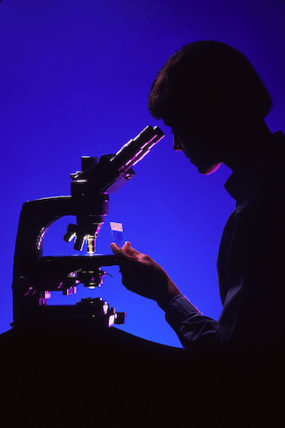 Scientist at microscope. (Source: Creative Commons)