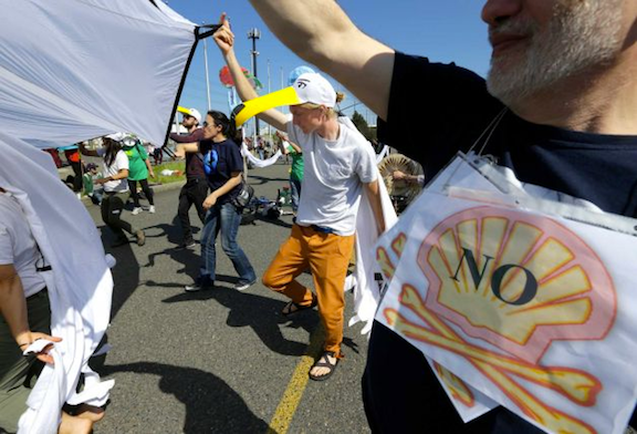 Hundreds of protesters gathered at the Port of Seattle's Terminal 5 on Monday, May 18, 2015. (Image Credit: Creative Commons)