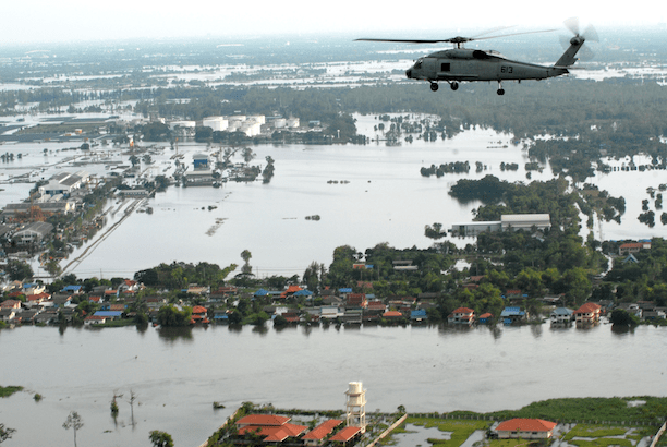 Severe flooding during the 2011 monsoon season in Thailand. In this photo, an SH-60F Sea Hawk helicopter flies around the Bangkok area. (Photo Credit: Petty Officer 1st Class Jennifer Villalovos)