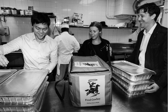 Robert Lee, Colleen Large and Matt de la Houssaye pick up food from Cipriani 42nd. (Photo via Global Green USA)