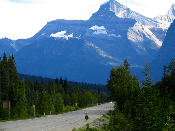 Tamara riding the Icefields Parkway, which connects Jasper and Banff National Parks, Alberta, Canada.