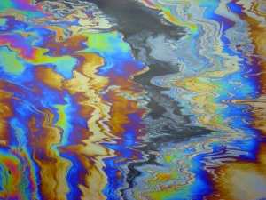 Oil on water. (Photo Credit: gambier20 / Flickr)
