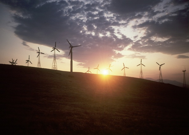 Wind turbines on a hill at sunset. (Photo Credit: Peter Banner)