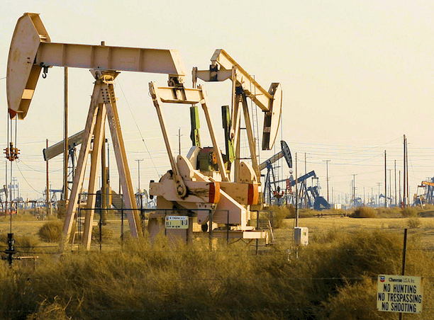 Oil well pump jacks at the Lost Hills Oil Field in central California. (Photo Credit: Richard Masoner)