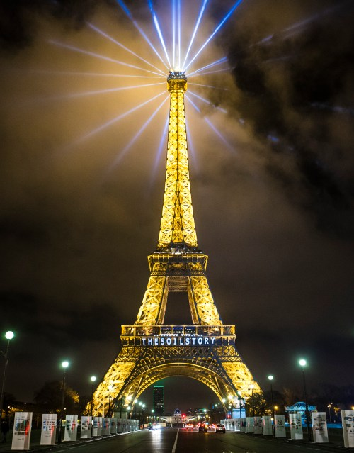 "The solution came to light with ""The Soil Story"", projected from the Eiffel Tower on December 10, 2015 during COP21. Image courtesy of the Kiss The Ground Movie."
