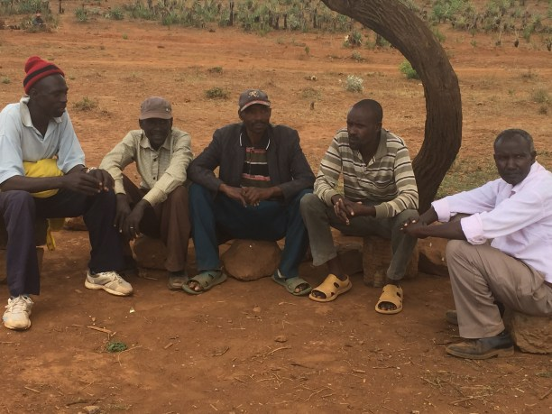 The men of Lemolo B discuss various micro-business opportunities for the community, from egg incubators to solar mills, to agri-processing equipment for irrigation. (Photo courtesy of INTASAVE)