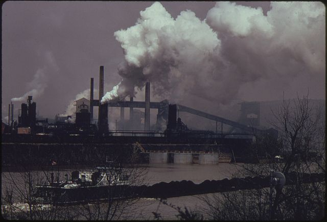 Coal barge crossing the Monongahela River past a U.S. coke plant in Clairton, Pennsylvania. (Photo Credit: John L. Alexandrowicz)