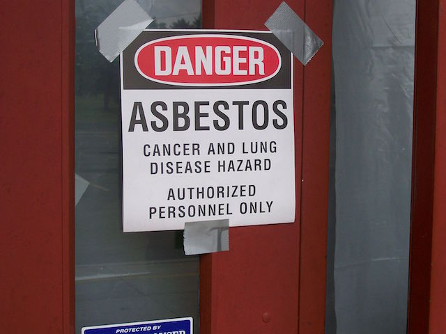 Asbestos warning at Bauer Elementary, Miamisburg, Ohio. (Photo Credit: Ktorbeck via WikiMedia Commons)