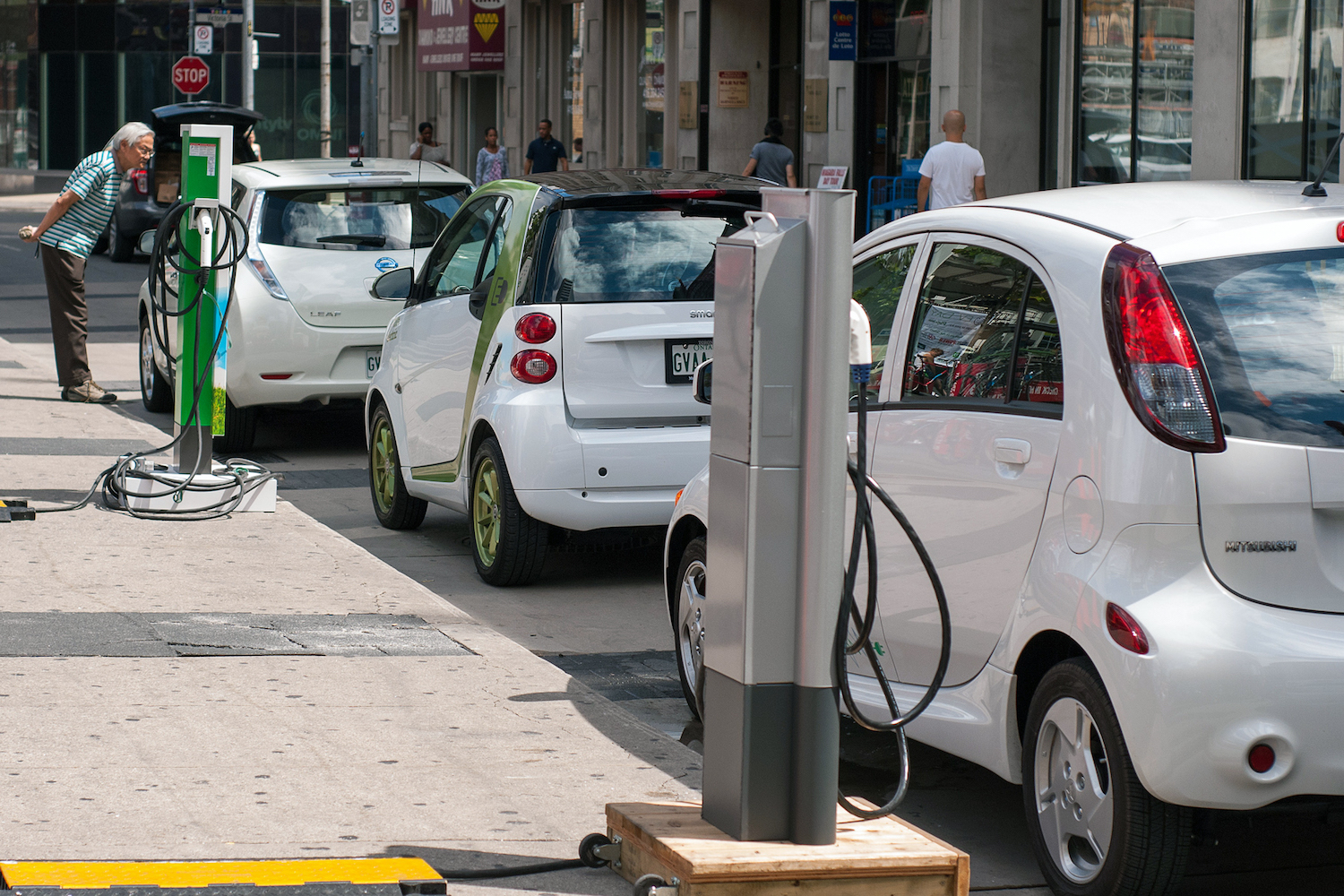 Norway's zero-emission plan would leave many streets looking like this one in downtown Toronto. Pictured: Electric cars charging at power meters. From farthest to closest, a Nissan Leaf, a Smart ED, and a Mitsubishi i MiEV. (Photo Credit: Plug'n Drive)