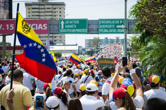 In February 2014, hundreds of thousands of Venezuelans protested in the streets over high levels of criminal violence, inflation and scarcity of basic goods. (Photo Credit: María Alejandra Mora)