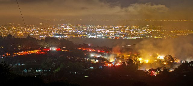 Fire burning from the San Bruno pipeline explosion, September 9, 2010. (Photo Credit: MisterOh via WikiMedia Commons)