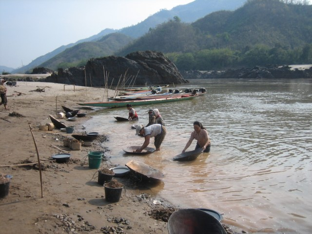 Panning for gold near the Xayaburi Mainstream Mekong Dam. (Photo Credit: Prince Roy / Flickr)
