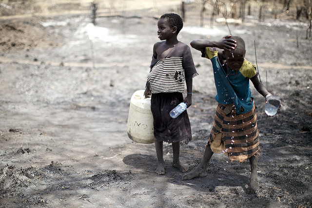 Girls carry water in a rural area of South Sudan. (Photo: Arsenie Coseac / Flickr)