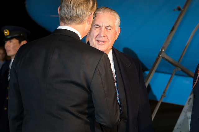 Secretary of State Rex Tillerson, right, is accused of using the alias Wayne Tracker to discuss climate change while working as ExxonMobil's CEO. (Photo: U.S. Embassy Tokyo / Flickr)