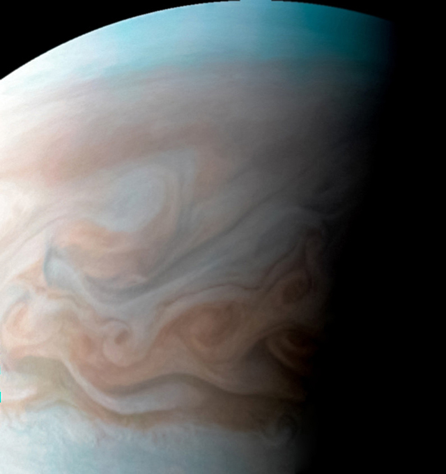 The pastel-colored clouds of Jupiter's upper atmosphere. (Photo: NASA / JPL)
