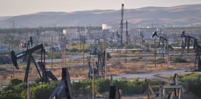 The San Ardo Oil Field From The Coast Starlight. The San Ardo Oil Field is a large oil field in Monterey County, California, in the United States. (Photo Credit: Loco Steve / Flickr)
