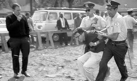 A young Bernie Sanders being arrested in 1963 civil rights protest in Chicago.