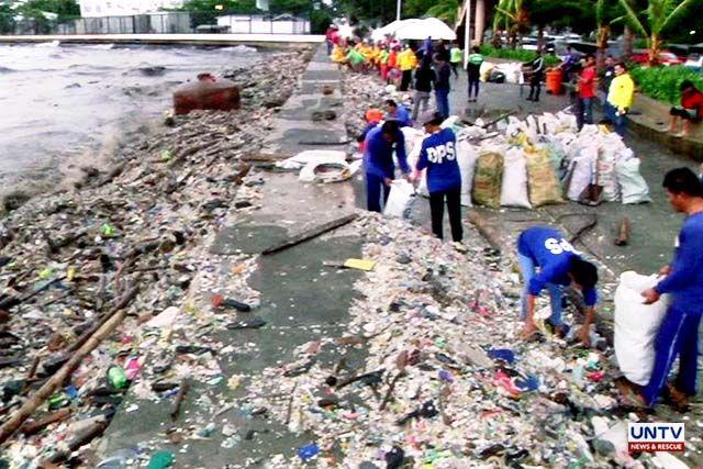 Monsoon rains spawn sea of garbage in Manila Bay