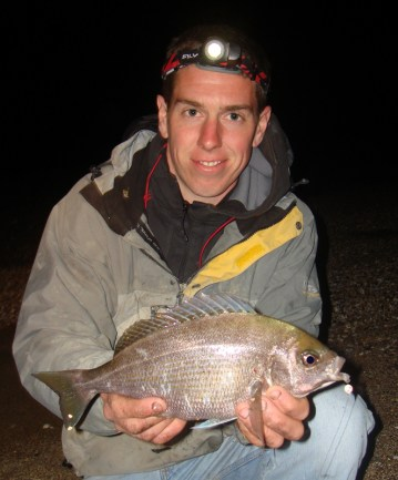 an angler with a shore caught black bream