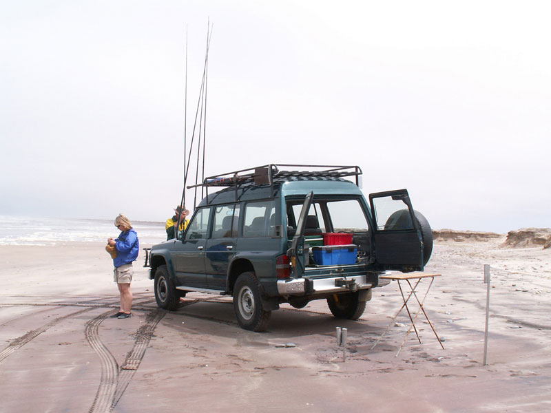 setting up camp on a Namibian beach