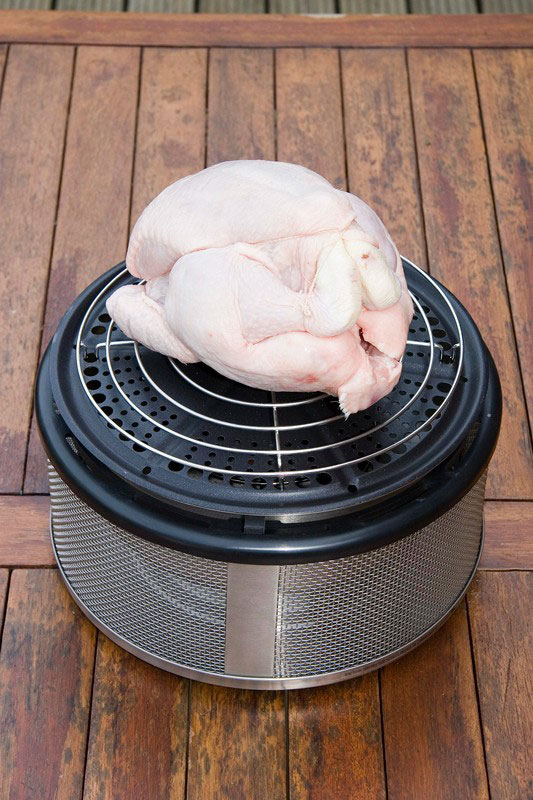 a chicken on the Cobb Grill