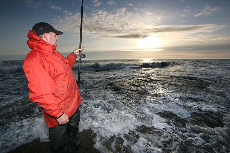 an angler surveys an powerful sea