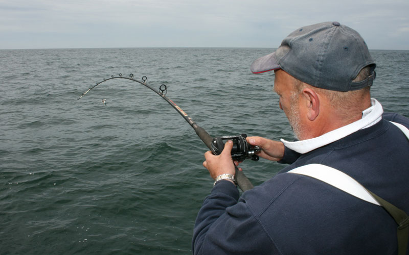 an angler enjoys a day on a charter boat