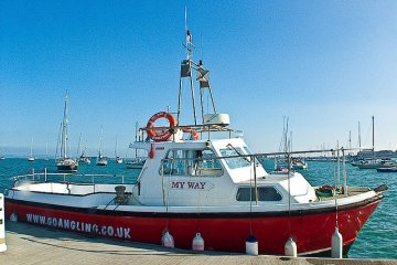 Holyhead charter boat MyWay tied to pontoon