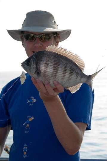 angler with black bream