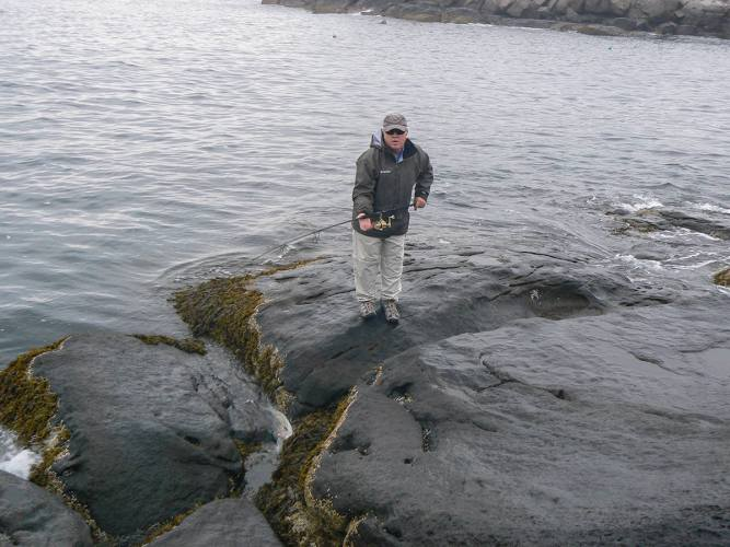 Jack working a striper into a rock crease