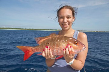 Bronwyn with the first Red snapper of the trip