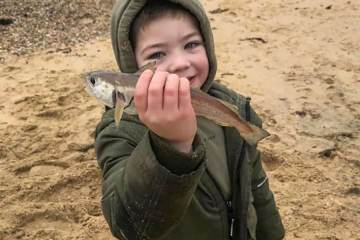 Oscar Barry aged 5 is looking very pleased with his first ever sea fish