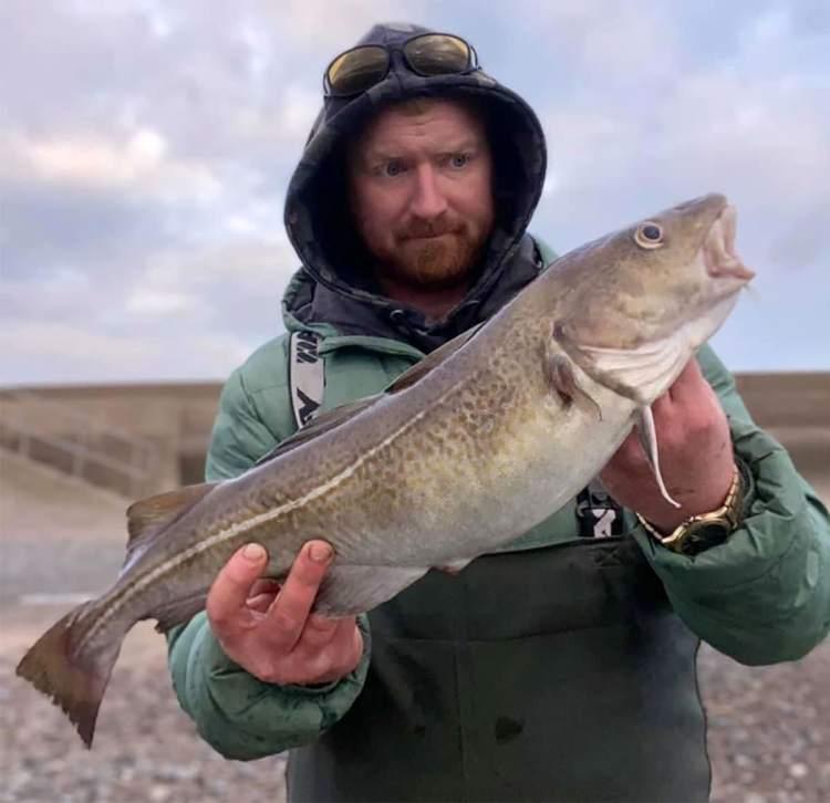 Luke Scott with his cod