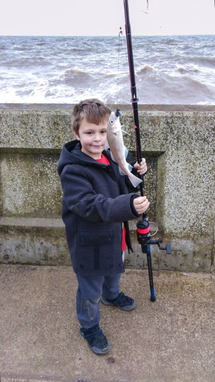 8 years old Jean-Luc with his first fish