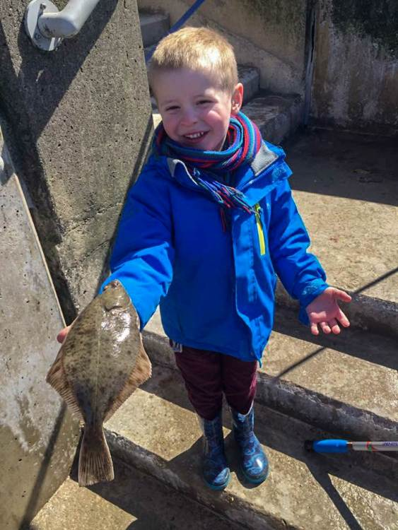 Four year old William Russon with his flounder