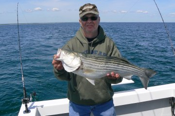 Dana witha 31 inch striped bass