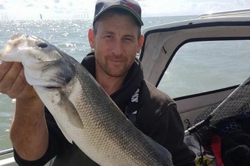 Martyn Smyth with his 6lb bass on a squid bait