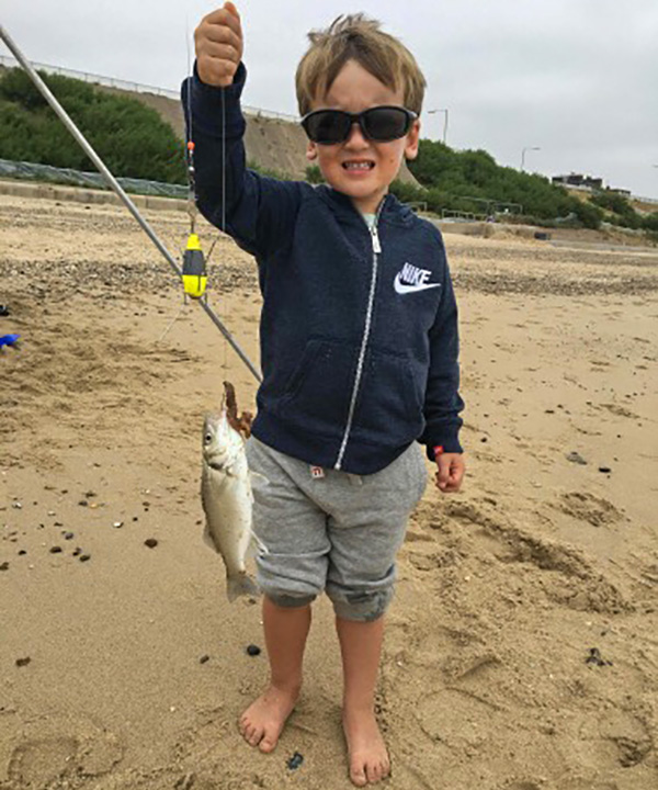 Young Oliver Rotchell with a bass