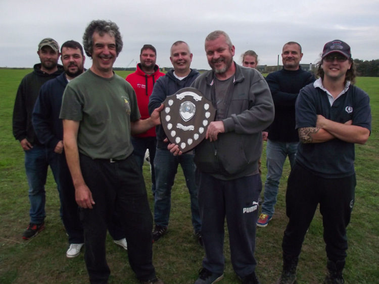 Mark Holmes being presented with the Vanguard Shield by Cain Plumb