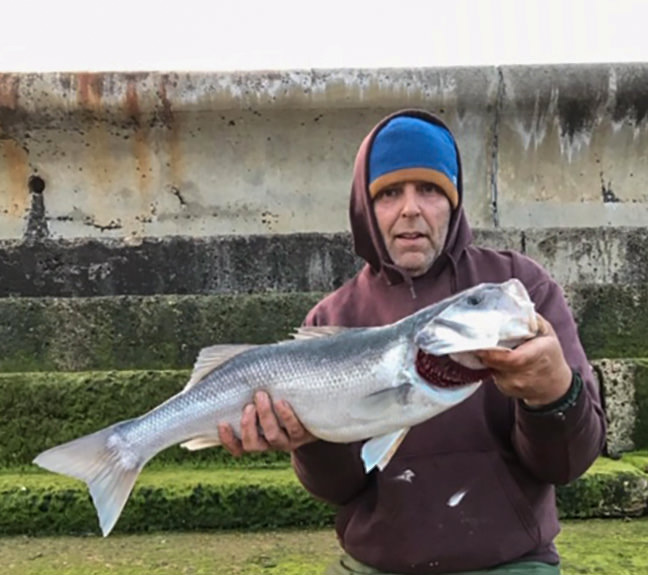 Paddy Stewart with a 8lb 1oz bass, he also landed a 6lb 4oz bass