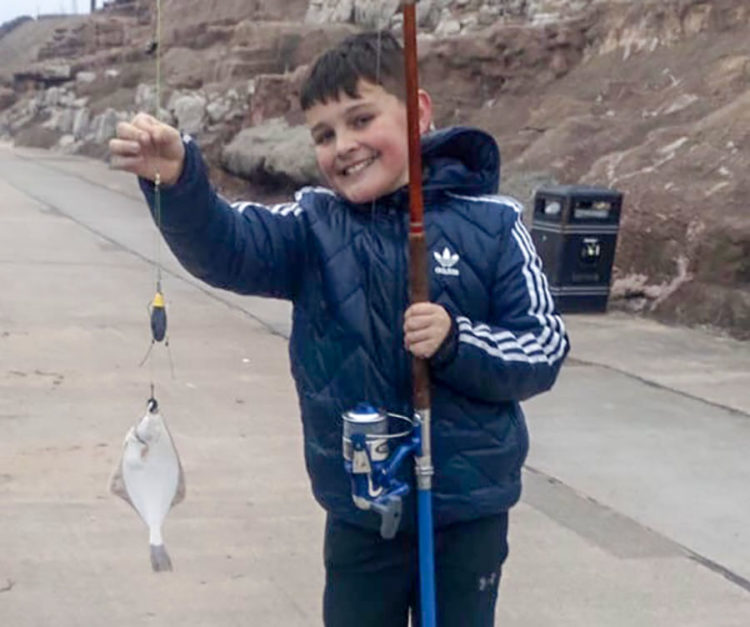 Harvey Dixon aged 10 out on his first ever fishing trip