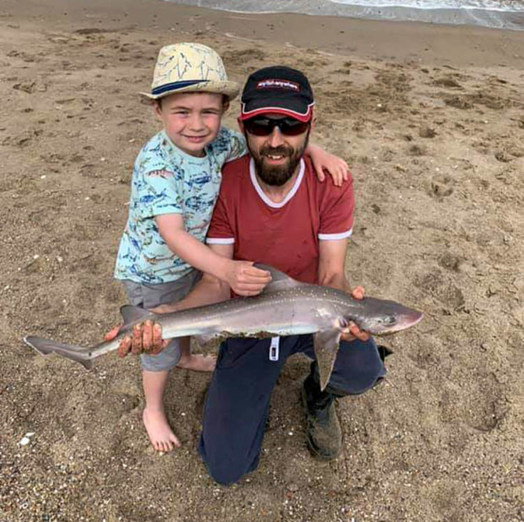 Second placed Mark Taylor and son Rex with the longest round fish