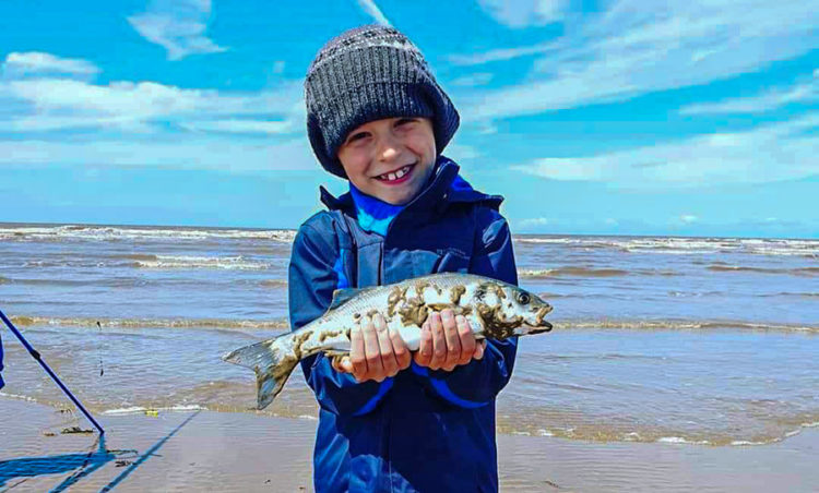 William Russon aged just 7 with a bass