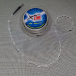 Tubing and beads threaded on trace body