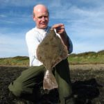 Ashley with a green tinged flounder